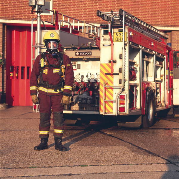 Wall Art - Photograph - Firefighter And Engine by Simon Lewis/science Photo Library