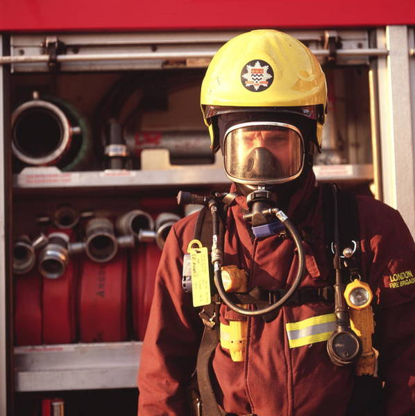 Wall Art - Photograph - Firefighter by Simon Lewis/science Photo Library
