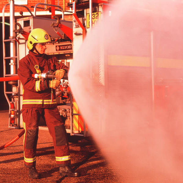 Wall Art - Photograph - Firefighter Using Hose by Simon Lewis/science Photo Library