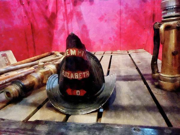 Photograph - Fireman - Fire Helmet In Fire Truck by Susan Savad