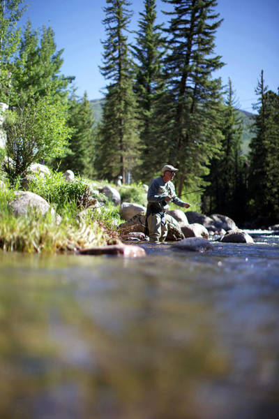 Fly Fishermen Photograph - Fisherman Goes Fly Fishing At A River by Priscilla Gragg