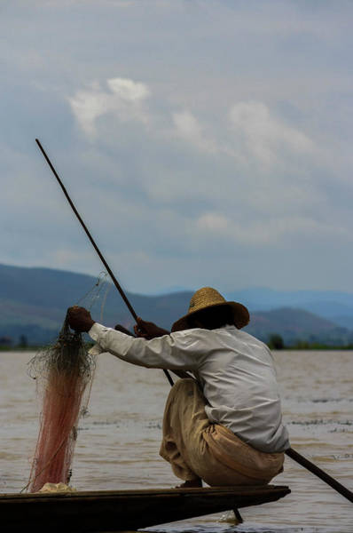 Real People Photograph - Fisherman In Inlé Lake by (c) Mélanie Golfieri
