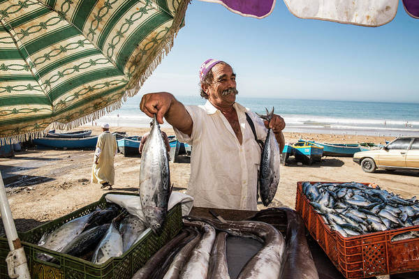 Sunshade Photograph - Fisherman Selling His Fish At Market On by Tim E White