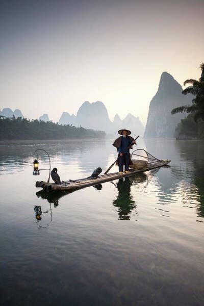 Raft Photograph - Fisherman With Cormorants On River by Matteo Colombo