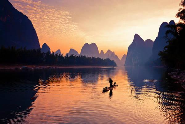 Raft Photograph - Fishermen Fishing In Li River by Bihaibo