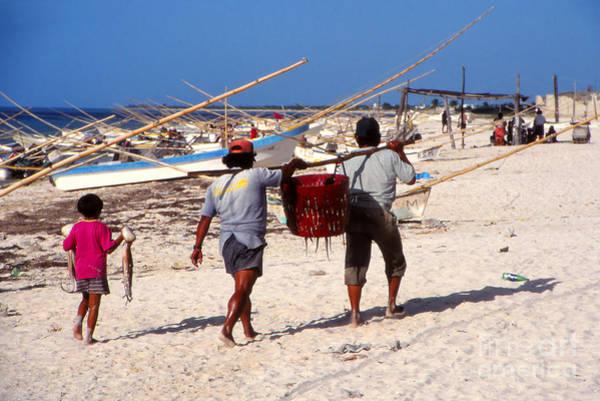 Puerto Plata Photograph - Fishermen On Beach by Eva Kato