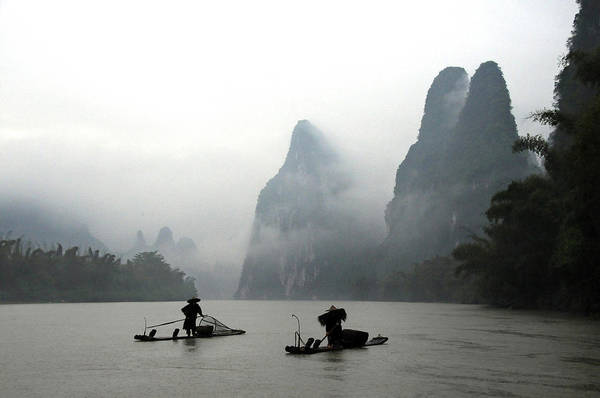 Raft Photograph - Fishermen With Bamboo Raft In Li River by Melindachan