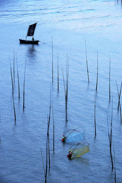 Working Photograph - Fishermen Working In High-tide Mudflats by Melindachan