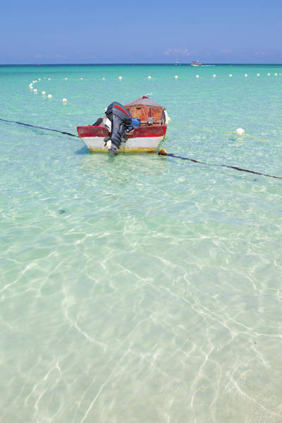 Jamaica Photograph - Fishing Boat On Idyllic Tropical Beach by Douglas Pearson