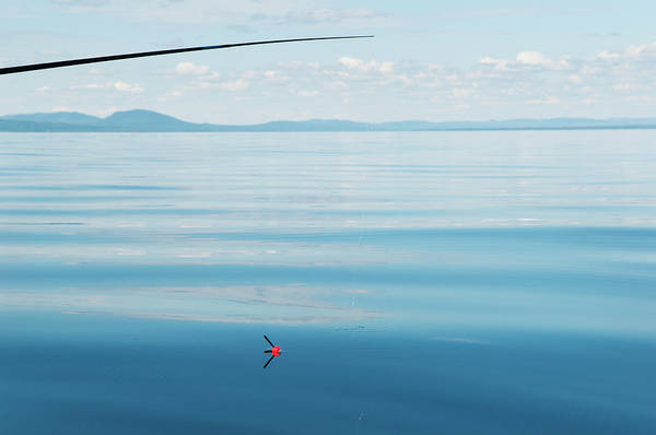 Fishing Tackle Photograph - Fishing In Sea by Johner Images