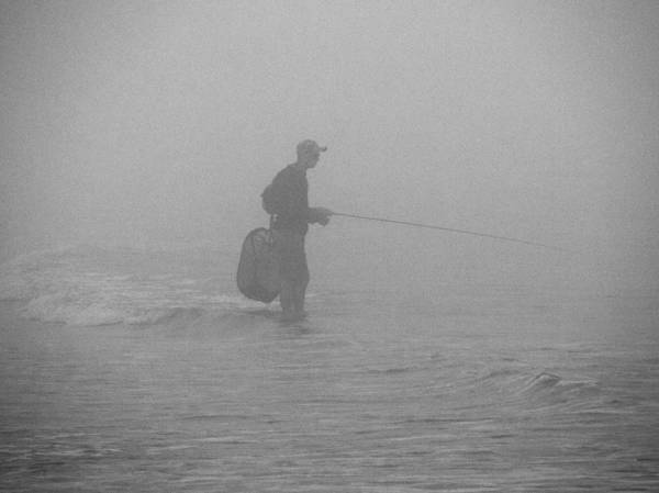 Photograph - Fishing In The Surf by Paul Ross