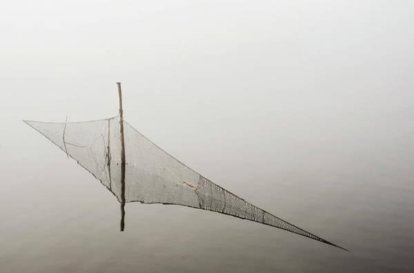 Skane Photograph - Fishing Net In Foggy Lake by Hoekan Jansson
