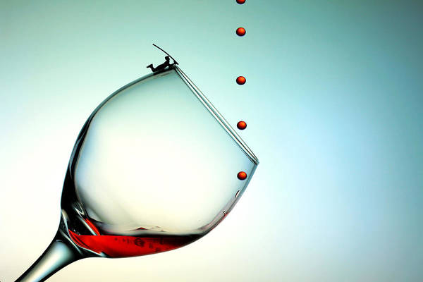 Wall Art - Photograph - Fishing On A Glass Cup With Red Wine Droplets Little People On Food by Paul Ge