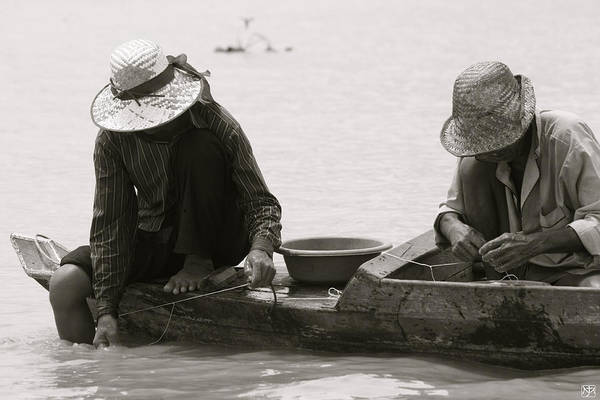 Photograph - Fishing On Tonle Sap by John Meader