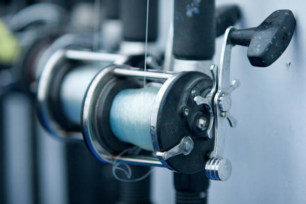 Angling Photograph - Fishing Reels On A Charter Boat by Justin Bailie