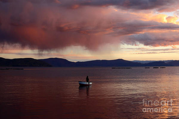 Photograph - Fishing Under Stormy Skies by James Brunker