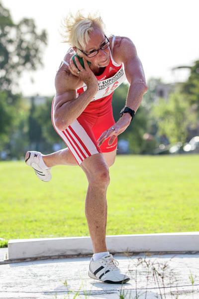 Determination Photograph - Fit Older Female Athlete Throws Shot Put by Alex Rotas