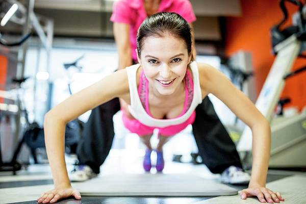 Self Confidence Photograph - Fitness Trainer Helping Woman by Science Photo Library