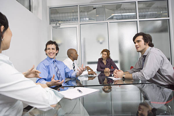 Five Businesspeople Sitting At Conference Table, Discussing Art Print by Bob Handelman