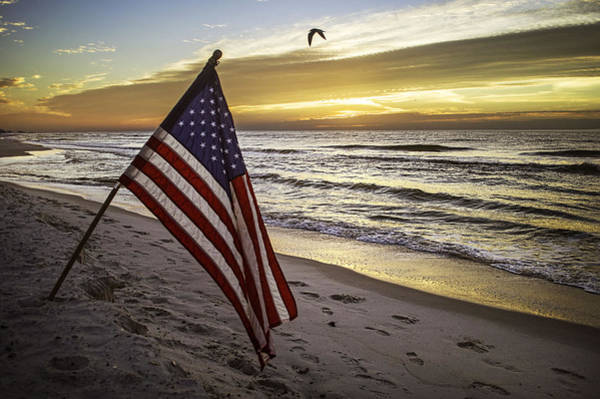 Photograph - Flag On The Beach 2 by Michael Thomas