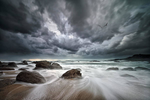Cloudy Photograph - Flight Over Troubled Waters by Santiago Pascual Buye