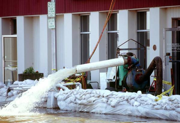 Street Machine Photograph - Flooded Building by David Hay Jones/science Photo Library