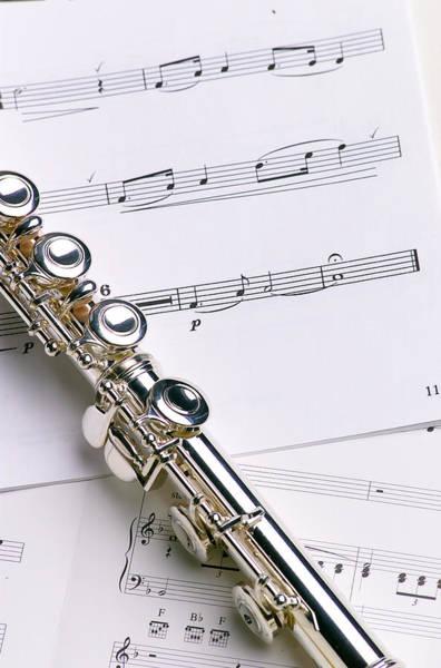 Flute Wall Art - Photograph - Flute On Music by Jon Neidert