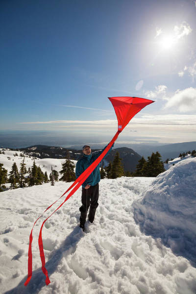 Flying Kite Photograph - Flying A Kite On A Snowy Mountain by Christopher Kimmel
