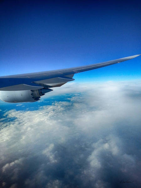 Photograph - Flying Above The Clouds by Diana Haronis