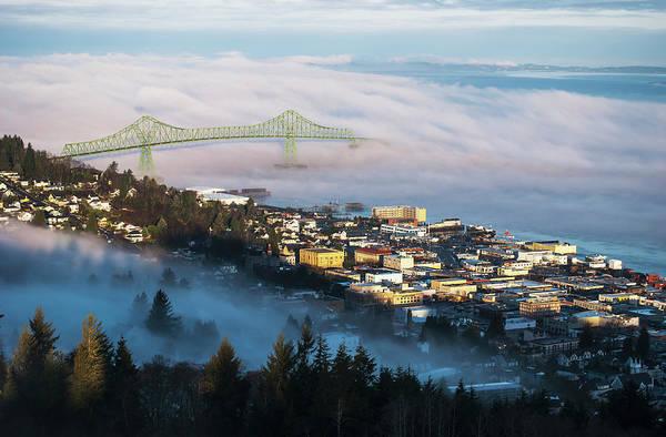 Astoria Bridge Photograph - Fog Hovers Over The Columbia River by Robert L. Potts