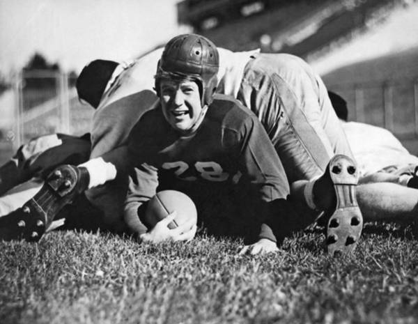 Playing Field Photograph - Football Player Gets Tackled by Underwood Archives