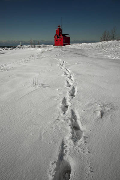 Holland State Park Photograph - Footprints Leading From The Lighthouse Big Red During Winter by Randall Nyhof