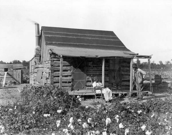 African American Woman Wall Art - Photograph - Former Slaves At Their Cabin by Underwood Archives