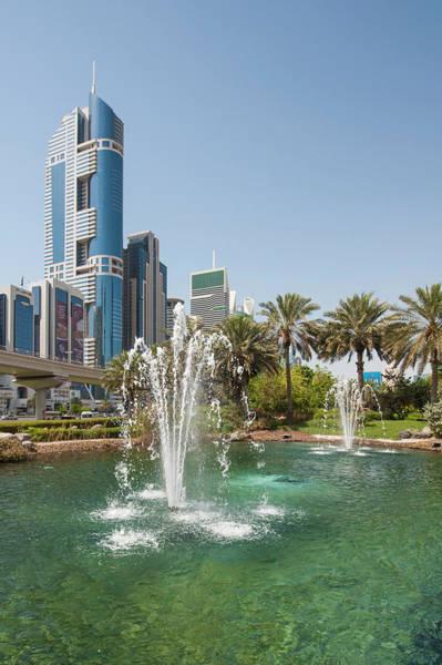 Condos Photograph - Fountain And Downtown Skyline Of Dubai by Michael Defreitas