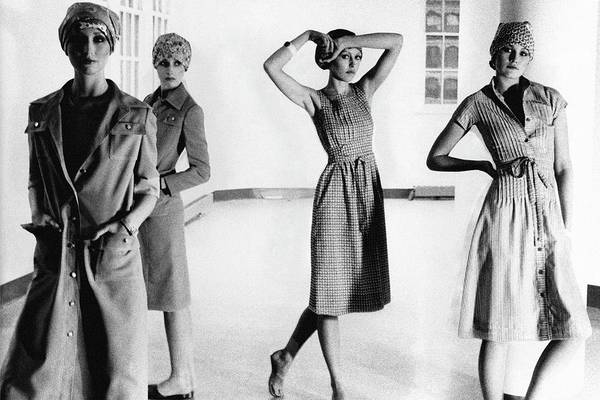 1975 Photograph - Four Models Standing In A Hallway by Deborah Turbeville