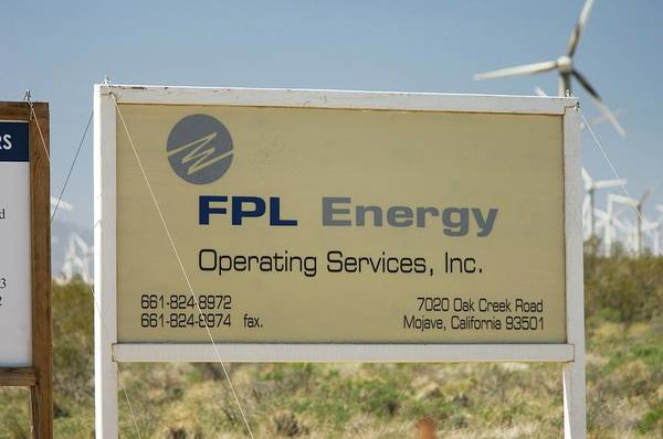 Controversial Wall Art - Photograph - Fpl Energy Sign by David Nunuk/science Photo Library