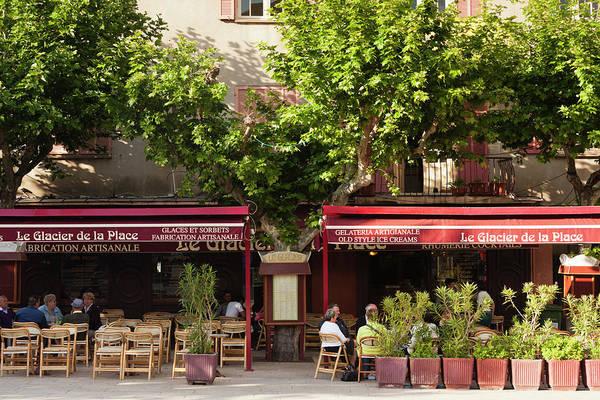 Outdoor Cafe Photograph - France, Corsica, Porto Vecchio by Walter Bibikow