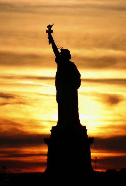 Photograph - Statue Of Liberty Silhouette by Bob Slitzan