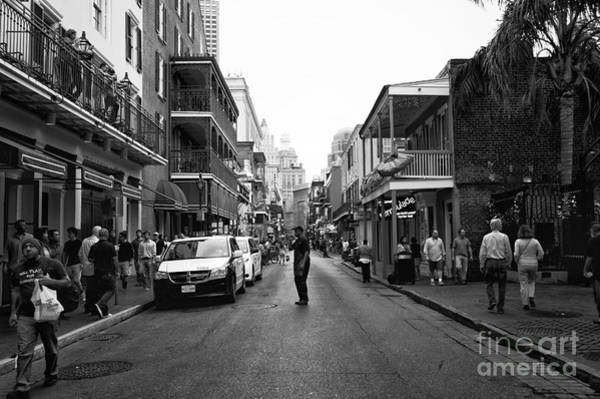 Wall Art - Photograph - Freeze Frame On Bourbon Street Mono by John Rizzuto