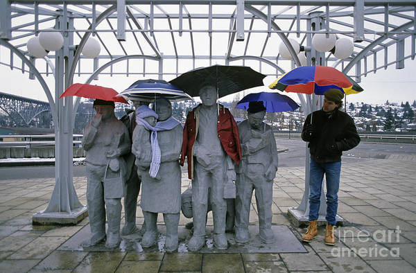Jim Richards Photograph - Fremont Statues With Man And Umbrellas by Jim Corwin