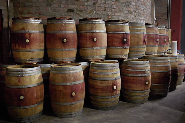 Winemaking Photograph - French Wine Barrels Stacked At Winery by Klaus Vedfelt