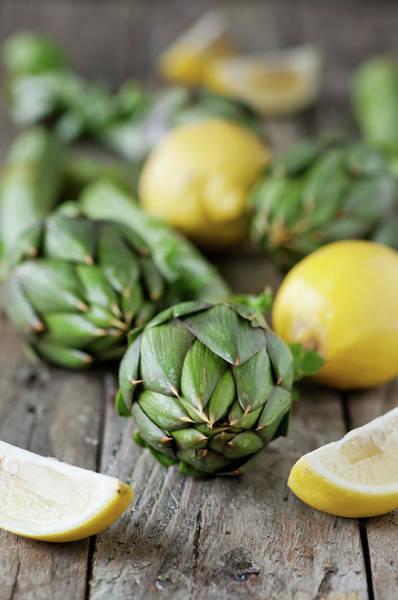 Lemon Photograph - Fresh Artichoke And Lemons by Oxana Denezhkina