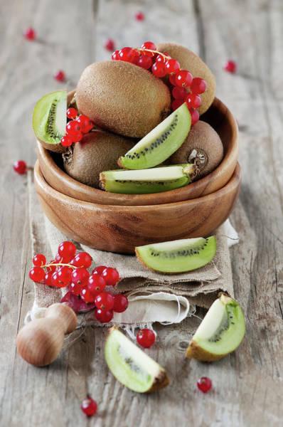 Currants Photograph - Fresh Kiwi And Redcurrant by Oxana Denezhkina