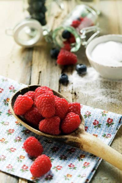 Bilberry Photograph - Fresh Raspberries On A Wooden Spoon by Foodcollection