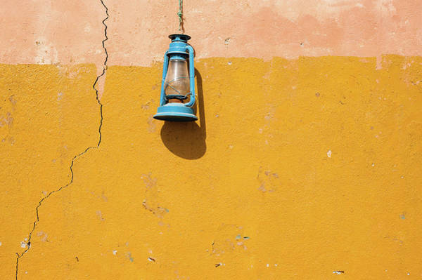 Hanging Photograph - Front View Of A Blue Gas Lamp Hanging by Mohamed El Hebeishy