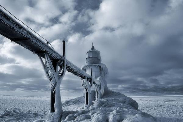 Wall Art - Photograph - Frozen Lighthouse In Saint Joseph Michigan by Dan Sproul