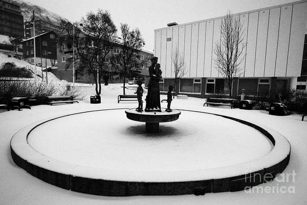 Wall Art - Photograph - Frozen Mother And Children Sculpture In Fountain In Hammerfest Town Square  Finnmark Norway Europe by Joe Fox