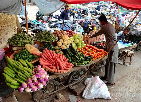 Fruit And Vegetable Seller Tends To His Cart Outside Empress Market Karachi Pakistan Art Print