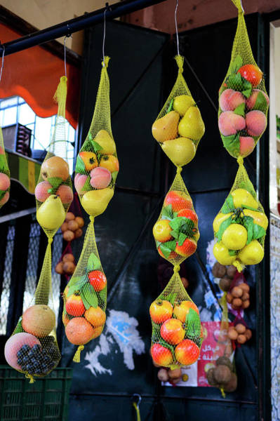 Hanging Photograph - Fruits Hanging From A Market Stall by Paolo Negri