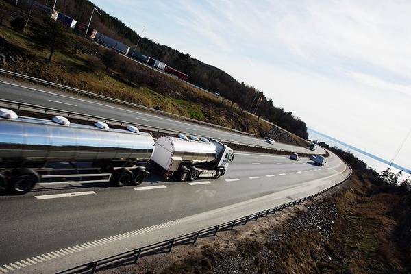 Logistics Photograph - Fuel Tanker Truck On Highway by Christian Lagerek/science Photo Library